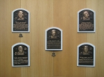 Placques showing the 5 original hall of fame members. Can you name them?
