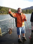 Joey catches a squid. Adventure Bay Bruny Island.  Feb 23