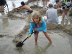 Cami digs her own personal hot tub at Hot Water Beach. Coromandel Peninsula March 6