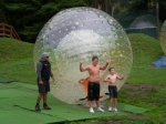 Joey and Tommy emerge from the Zorb. rotorura New Zealand. March 4