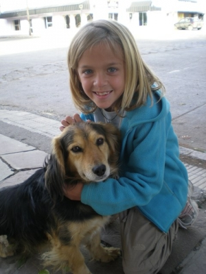 Always a friend to dogs, Cami cuddles with one of Argentinia's many strays. April 14, 2008