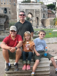 The kids enjoy their dollar snacks in the Roman coliseum